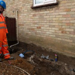 Injecting polymer resin to stabilise soil and underpin a house