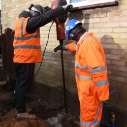 Creating injection hole for polymer resin to stabilise soil and underpin a house